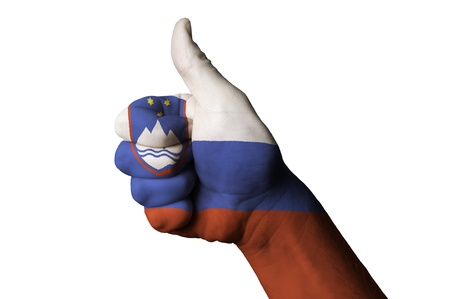 Hand with thumb up gesture in colored slovenia national flag as symbol of excellence, achievement, good, - useful for tourism and touristic advertising and also current positive political, cultural, social management of state or country