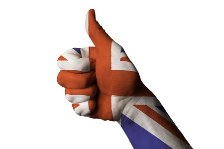 Hand with thumb up gesture colored in great britain national flag as symbol of excellence, achievement, good, - useful for tourism and touristic advertising and also current positive political, cultural, social management of state or country photo
