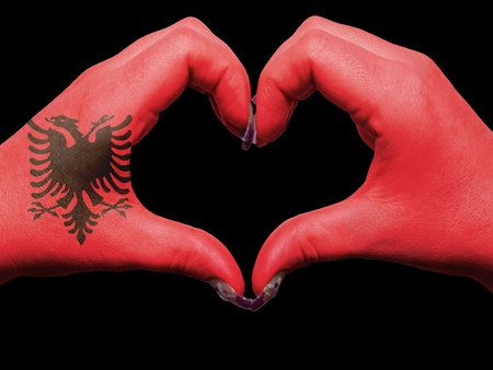 albanian: Gesture made by albania flag colored hands showing symbol of heart and love Stock Photo