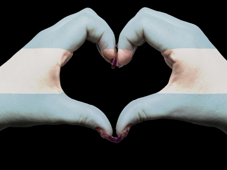 Tourist gesture made by argentina flag colored hands showing symbol of heart and love photo