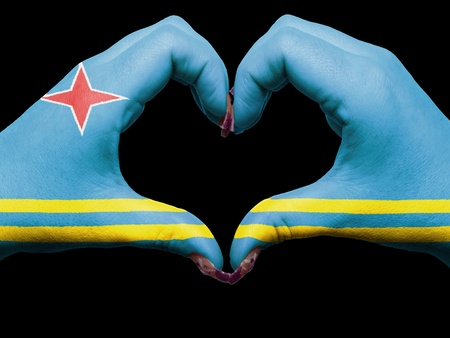 aruba flag: Gesture made by aruba flag colored hands showing symbol of heart and love