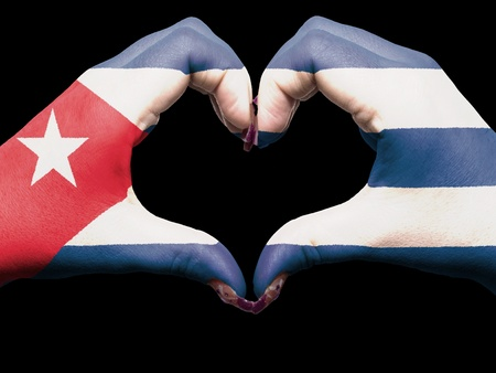 Gesture made by cuba flag colored hands showing symbol of heart and love