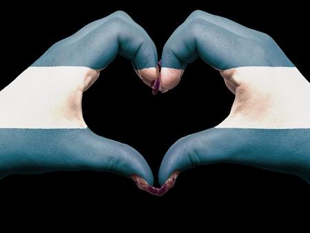 el salvadoran: Gesture made by el salvador flag colored hands showing symbol of heart and love