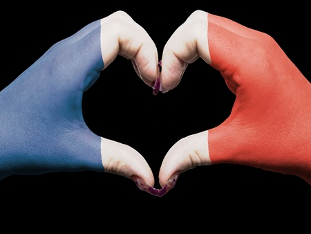 Gesture made by france flag colored hands showing symbol of heart and love photo