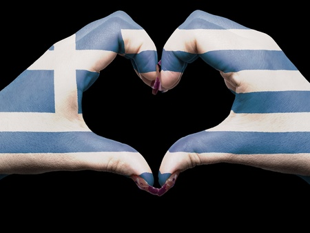 Gesture made by greece flag colored hands showing symbol of heart and love photo