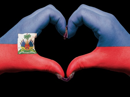 haiti: Gesture made by haiti flag colored hands showing symbol of heart and love