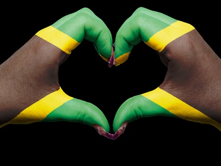 jamaica: Tourist peru made by jamaica flag colored hands showing symbol of heart and love Stock Photo