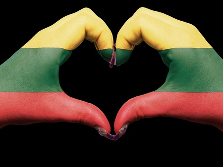 lithuanian: Gesture made by lithuania flag colored hands showing symbol of heart and love