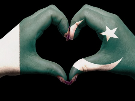 Tourist made gesture  by pakistan flag colored hands showing symbol of heart and love photo
