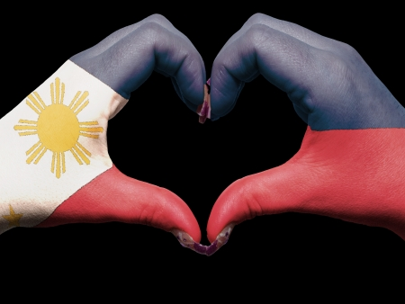 Tourist made gesture  by philippines flag colored hands showing symbol of heart and love