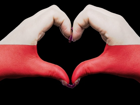 Gesture made by poland flag colored hands showing symbol of heart and love photo