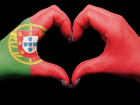 made in portugal: Gesture made by portugal flag colored hands showing symbol of heart and love Stock Photo
