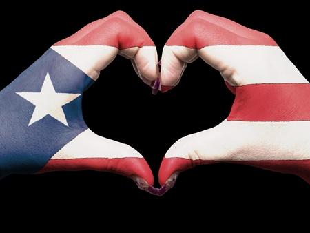 bandera de puerto rico: Turismo de Trinidad y Tobago hecha por manos Bandera de Puerto Rico de colores que muestran el s�mbolo del coraz�n y el amor Foto de archivo