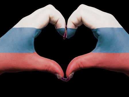 Gesture made by russia flag colored hands showing symbol of heart and love photo