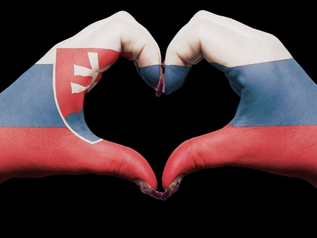 Gesture made by slovakia flag colored hands showing symbol of heart and love photo