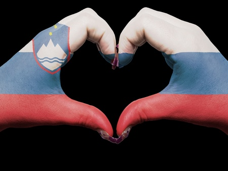 Gesture made by slovenia flag colored hands showing symbol of heart and love photo