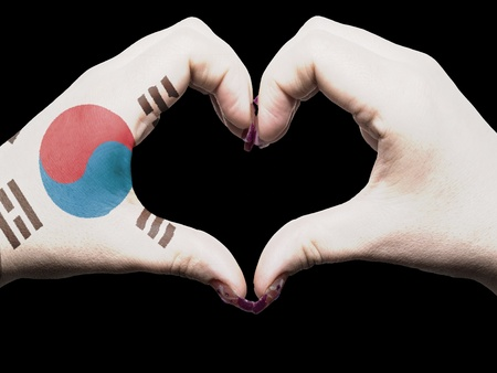 Tourist made gesture  by south korea flag colored hands showing symbol of heart and love photo