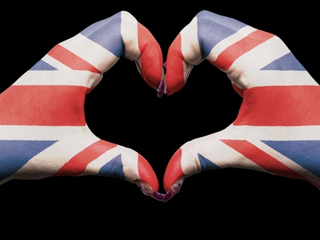 Gesture made by great britain flag colored hands showing symbol of heart and love photo