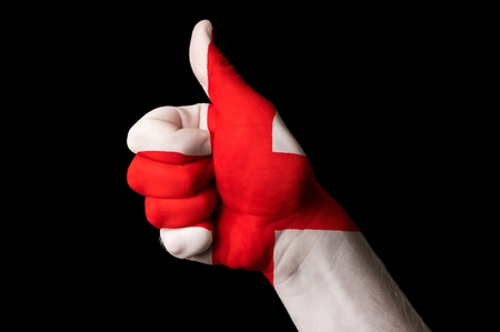 Hand with thumb up gesture colored in england national flag Stock Photo - 13038660