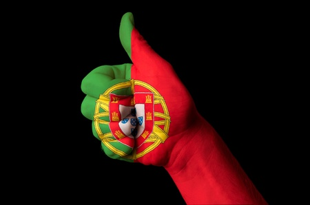 Hand with thumb up gesture colored in portugal national flag photo