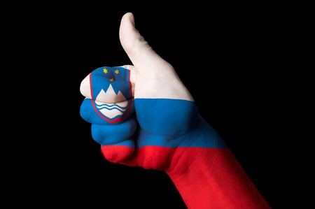 Hand with thumb up gesture in colored slovenia national flag Stock Photo - 13038638