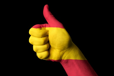 champion of spain: Hand with thumb up gesture in colored spain national flag