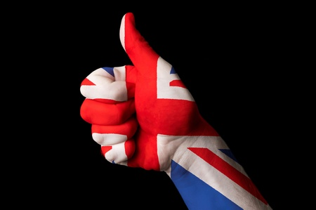 Hand with thumb up gesture colored in great britain national flag  photo