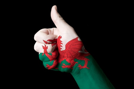 welsh flag: Hand with thumb up gesture in colored wales national flag
