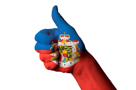 Hand with thumb up gesture in colored liechtenstein national flag Stock Photo