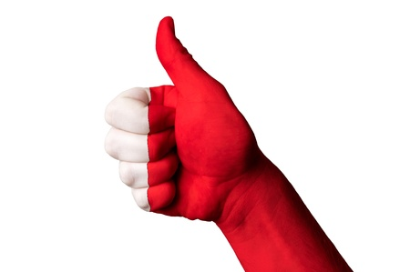 Bahrain: Hand with thumb up gesture in colored bahrain national flag Stock Photo