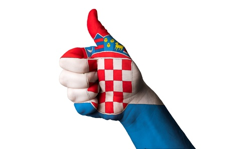 Hand with thumb up gesture colored in croatia national flag  photo