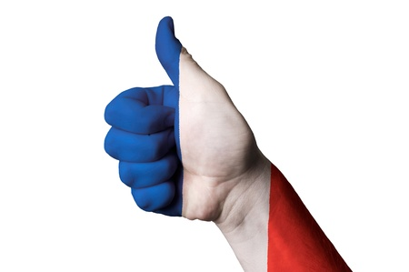 Hand with thumb up gesture colored in france national flag photo