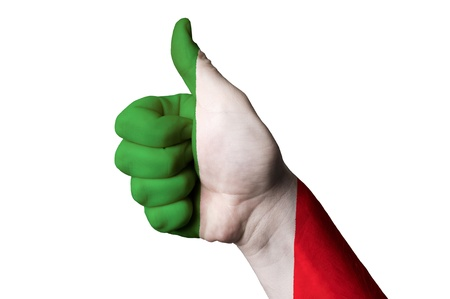 Hand with thumb up gesture in colored italy national flag photo