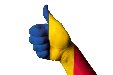 Hand with thumb up gesture in colored romania national flag  photo