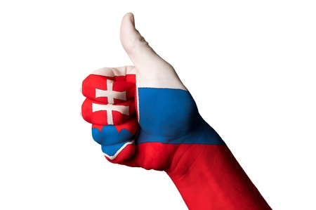 Hand with thumb up gesture in colored slovakia national flag  photo