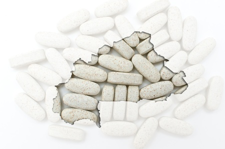 Outline burkina faso map with transparent background of capsules symbolizing pharmacy and medicine Stock Photo - 13207678