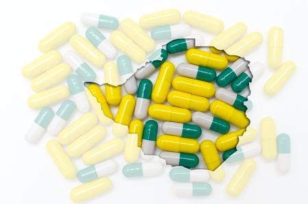 Outline zimbabwe map with transparent background of capsules symbolizing pharmacy and medicine Stock Photo - 13207716