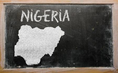 drawing of nigeria on blackboard, drawn by chalk photo