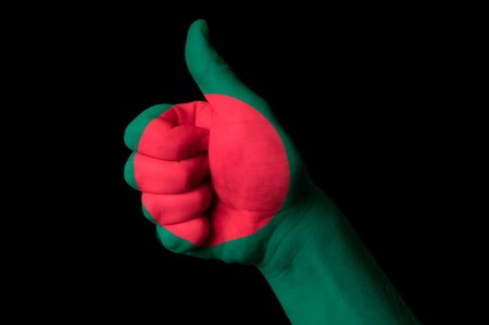 Hand with thumb up gesture in colored bangladesh national flag as symbol of excellence, achievement, good, - for tourism and touristic, advertising, positive political, cultural, social management of country photo