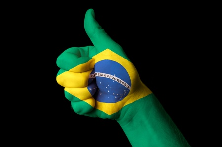 Hand with thumb up gesture in colored brazil national flag as symbol of excellence, achievement, good, - for tourism and touristic advertising, positive political, cultural, social management of country Stock Photo - 13208085
