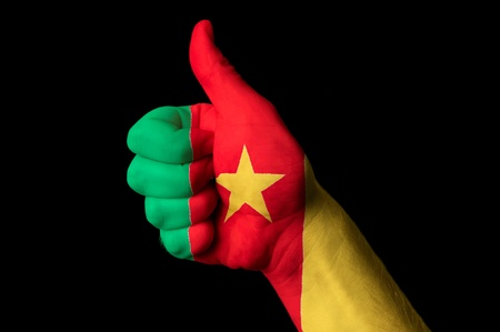 Hand with thumb up gesture in colored cameroon national flag as symbol of excellence, achievement, good, - for tourism and touristic advertising, positive political, cultural, social management of country Stock Photo - 13208009