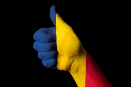 Hand with thumb up gesture in colored chad national flag as symbol of excellence, achievement, good, - for tourism and touristic advertising, positive political, cultural, social management of country