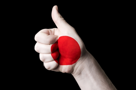 Hand with thumb up gesture in colored japan national flag as symbol of excellence, achievement, good, - for tourism and touristic advertising, positive political, cultural, social management of country