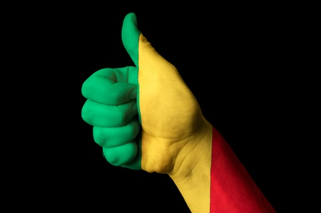 Hand with thumb up gesture in colored mali national flag as symbol of excellence, achievement, good, - for tourism and touristic advertising, positive political, cultural, social management of country photo