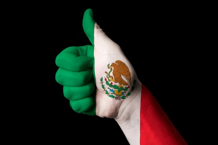 Hand with thumb up gesture in colored mexico national flag as symbol of excellence, achievement, good, - for tourism and touristic advertising, positive political, cultural, social management of country