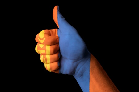 Hand with thumb up gesture in colored mongolia national flag as symbol of excellence, achievement, good, - for tourism and touristic advertising, positive political, cultural, social management of country Stock Photo - 13208063