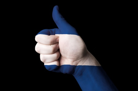 Hand with thumb up gesture in colored nicaragua national flag as symbol of excellence, achievement, good, - for tourism and touristic advertising, positive political, cultural, social management of country photo
