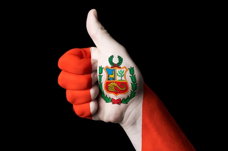 touristic: Hand with thumb up gesture in colored peru national flag as symbol of excellence, achievement, good, - for tourism and touristic advertising, positive political, cultural, social management of country Stock Photo