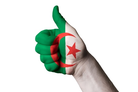 touristic: Hand with thumb up gesture in colored algeria national flag as symbol of excellence, achievement, good, - for tourism and touristic advertising, positive political, cultural, social management of country Stock Photo