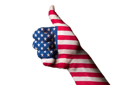 Hand with thumb up gesture in colored america national flag as symbol of excellence, achievement, good, - for tourism and touristic advertising, positive political, cultural, social management of country